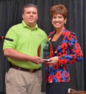 Denise is presented with the coveted 2013 Patsy B. Smith award by John Sneed on behalf of the Association Executives of North Carolina